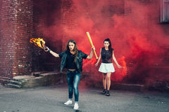Two young fans with Molotov cocktail and red smoke bomb Royalty Free Stock Photography