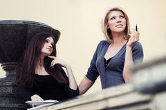 Two young fashion female students on campus Stock Photography