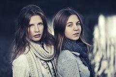 Two young fashion girls walking by the lake Stock Photo