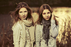 Two young fashion girls walking by the lake Royalty Free Stock Photos