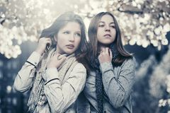 Two young fashion teen girls in autumn park Royalty Free Stock Images