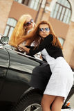 Two young fashion women at the retro car Stock Image