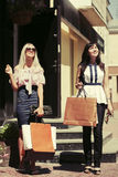 Two young fashion women with shopping bags Royalty Free Stock Photography
