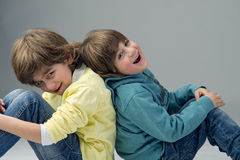 Two young fashionable brothers having fun Royalty Free Stock Images