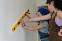 Two young female decorators Royalty Free Stock Photography