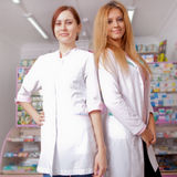Two young female doctor smiling at camera Royalty Free Stock Photos