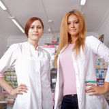 Two young female doctor smiling Royalty Free Stock Images