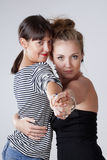 Two Young Female Friends Dancing Tango Stock Images