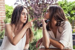 Two young female friends having fun singing a new song. On the microphone Royalty Free Stock Images
