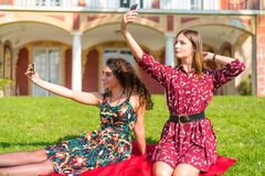 Two friends taking a selfie royalty free stock photo