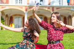 Two friends taking a selfie stock photos