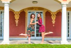 Two girls holding hands and having fun stock photos