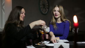 Two young female laughing and relaxing with cup of tea. Two young female laughing and relaxing with cup of coffee stock video