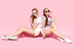 Young women sitting on skateboard stock photo