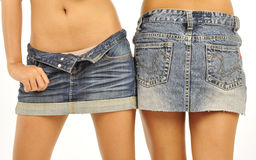 Two young female models wearing mini skirts Royalty Free Stock Photography
