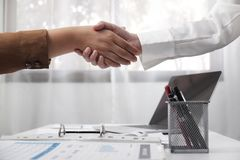 Two young female professional shaking hand business concept stock photo