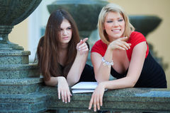 Two young female students Royalty Free Stock Photos