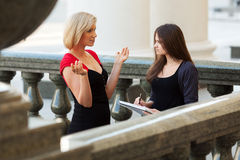 Two young female students on campus Royalty Free Stock Photo