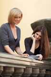 Two young female students on campus Stock Image