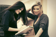 Two young female students on campus Stock Images
