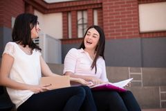 Two young female students preparing for exams royalty free stock photos