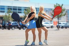 Two young female tennis players stock photography