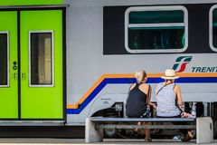 Two Young Female Travelers waiting for a train. Two young females waiting for a train in a station in Italy stock photos
