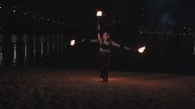 Firegirls performing fireshow with burning torches stock footage