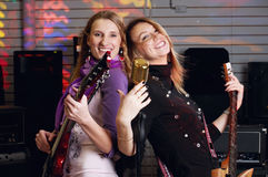 Two young females with rock guitar Stock Photography