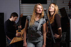 Two young females sign the song Royalty Free Stock Images
