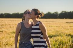 Two young females walking and relaxing in sunny day royalty free stock photography