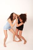 Two young fighting women 2 stock image