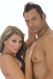 Two young fit models. One caucasian woman and muscular hispanic male fashion model against white background Royalty Free Stock Image