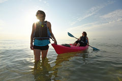 Two young fit women in kayak stock images