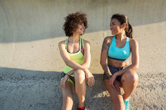 Two young fitness women in sportswear talking Royalty Free Stock Image