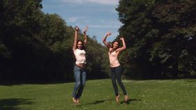 Two young friend jumping in the air. In slow motion stock footage