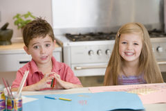 Two Young Friends Drawing Pictures Royalty Free Stock Image