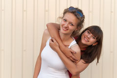 Two young friends having fun together. Stock Photos