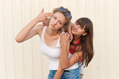 Two young friends having fun together. Royalty Free Stock Images
