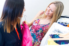 Two young friends looking for clothes in the store Royalty Free Stock Image