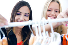 Two young friends looking for clothes in the store Stock Image