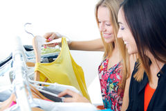 Two young friends looking for clothes in the store Stock Photography