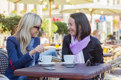 Two young friends meeting for a coffee Stock Photos