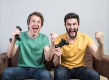 Friends playing video games Stock Images