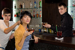 Two young friends relaxing in a pub royalty free stock photo