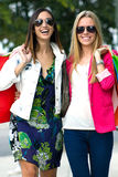 Two young friends shopping together Stock Images