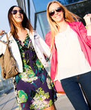 Two young friends shopping together Royalty Free Stock Image