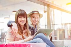 Two young friends with tablet computer royalty free stock photos