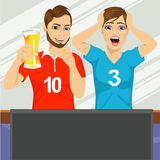 Two young friends watching sports game. Illustration of two young friends watching sports game on television together and drinking beer Stock Photo