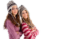 Two young friends wearing woolen cap stock image
